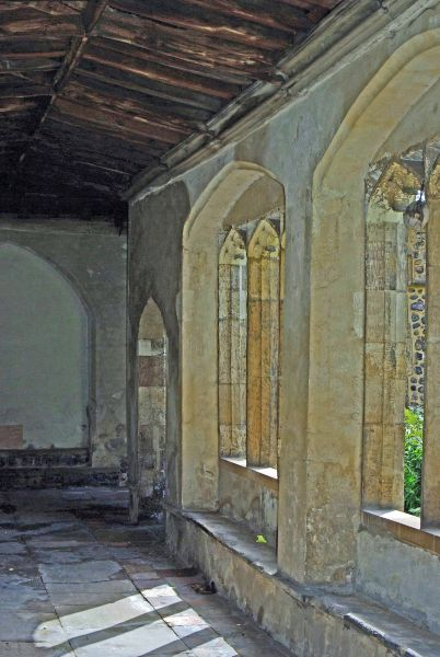 Image of the stone cloister  window and floor at the medieval Great Hospital Norwich